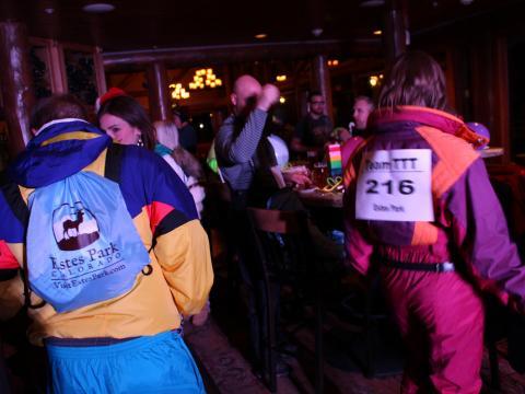 Wearing retro ski gear for festive entertainment on the Tinsel Tavern Tour